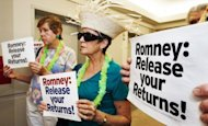 Protesters in July 2012 at Mitt Romney's campaign office in Arlington, Virginia, calls for the Republican presidential nominee to release more of his tax returns. Romney paid $1.9 million in taxes on income of $13.6 million in 2011, an effective rate of 14.1 percent, his campaign said, citing returns filed.