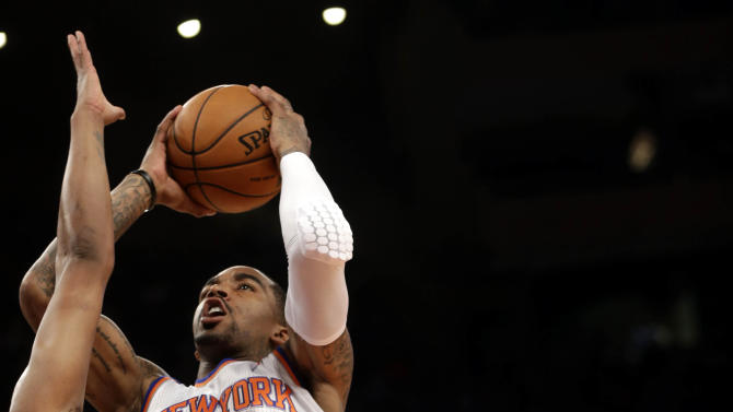 New York Knicks' J.R. Smith, right, shoots past Boston Celtics' Paul Pierce during the first half of the NBA basketball game at Madison Square Garden, Sunday, March 31, 2013, in New York. (AP Photo/Seth Wenig)