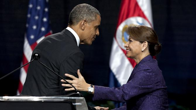 "President Barack Obama and Costa Rica's President Laura Chinchilla shake hands at the end of their joint press conference in San Jose, Costa Rica, Friday, May 3, 2013. Obama's three-day visit to Mexico and Costa Rica is his first to Latin America since winning a second presidential term. Obama on Friday cast Mexico as a nation ready to take ""its rightful place in the world"" and move past the drug battles and violence that have defined its relationship with the United States. He then headed to Costa Rica to prod Central American leaders to tackle those same issues more aggressively. (AP Photo/Moises Castillo)"