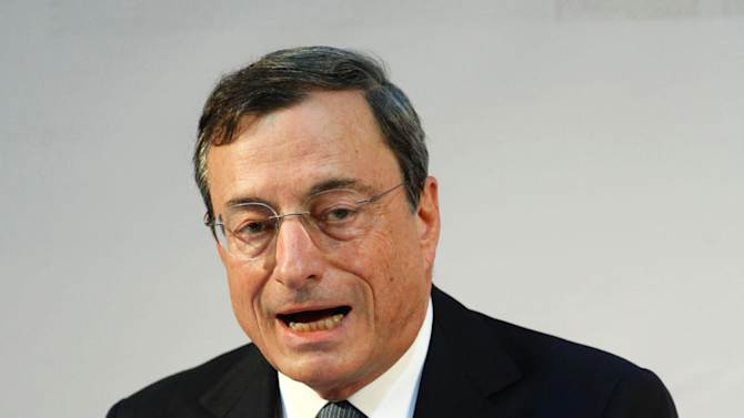 """European Central Bank head Mario Draghi meets the journalists at the end of the ECB governing council meeting in Naples, Italy, Thursday, Oct. 2, 2014. Draghi underlined the bank's willingness to ramp up its stimulus efforts with large-scale bond purchases if needed — but otherwise offered no new economic help at the bank's meeting Thursday. Draghi called the economic recovery in the 18 countries euro """"weak, fragile, and uneven."""" Even so, he chose instead to stress what the bank has already done, and repeated previous statements about the bank's willingness to do more. Markets seemed to think Draghi had offered less than hoped. The euro rose to $1.2654 from $1.2630 before Draghi's comments, a sign currency traders expect less rather than more future stimulus. Stocks fell 1 percent in Germany, 1.9 percent in France and 0.8 percent in Britain. Italy's FTSE MIB fell 3.1 percent. (AP Photo/Salvatore Laporta)"""