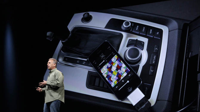 Phil Schiller, Apple's senior vice president of worldwide marketing, speaks on stage about new connectivity features during an introduction of the new iPhone 5 in San Francisco, Wednesday Sept. 12, 2012. (AP Photo/Eric Risberg)