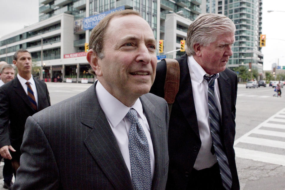 NHL commissioner Gary Bettman, center, and Toronto Maple Leafs general manager Brian Burke, right, arrive for collective bargaining talks in Toronto on Tuesday, Aug. 14, 2012. Negotiations continue between the league and the NHLPA to avoid a potential lockout. (AP Photo/The Canadian Press, Chris Young)