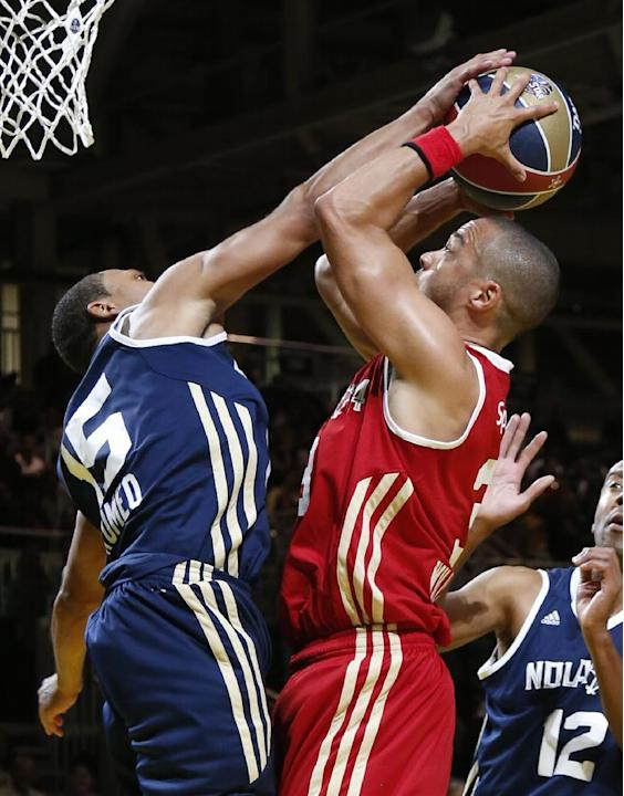 East's Romeo Miller (15) blocks the shot of West's Jesse Williams (3) in the second half as they participate in the NBA All-Star Celebrity basketball game in New Orleans, Friday, Feb. 14, 2014