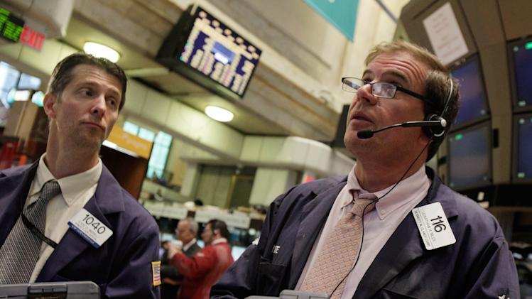 Traders Todd Ingrilli, left, and Jonathan Niles work on the floor of the New York Stock Exchange Monday, June 18, 2012. U.S. stocks are falling after the opening bell as Europe's debt crisis roils markets despite the victory of a pro-Europe party in Greek elections. (AP Photo/Richard Drew)