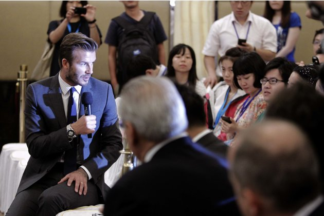 Former England soccer captain David Beckham answers questions from the media during a news conference in Shanghai