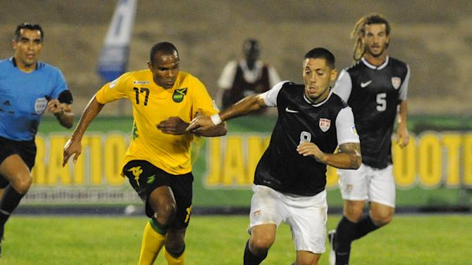 United States' Clint Dempsey, right, is challenged by Jamaica's Jevaughn Watson during a 2014 World Cup qualifying soccer match in Kingston, Jamaica, Friday, Sept. 7, 2012. (AP Photo/Collin Reid)
