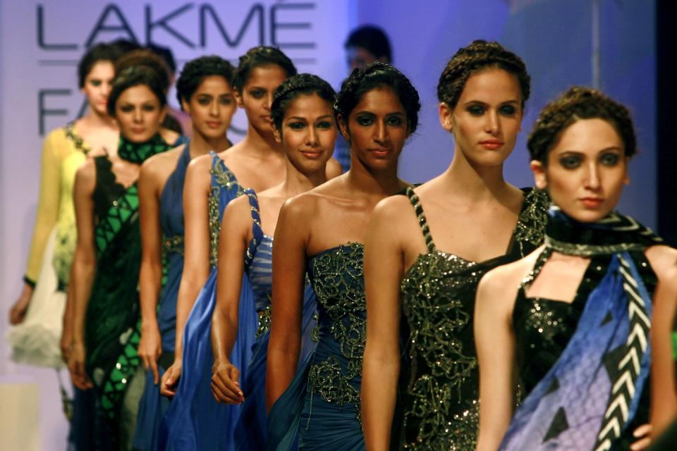 Indian models display creations by  Archana Kochhar during the Lakme Fashion Week in Mumbai, India, Tuesday, Aug. 7, 2012.(AP Photo/Rafiq Maqbool)