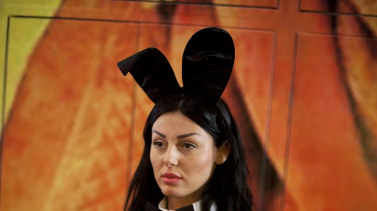 "A model dressed as a Playboy bunny poses during the lunch of the first Hebrew language edition of the popular men's magazine in Tel Aviv, Israel, Tuesday, March 5, 2013. Israelis can now read Playboy ""for the articles."" A U.S. emigre, Daniel Pomerantz, on Tuesday launched the first Hebrew language edition of the popular men's magazine. Playboy has been widely available in Israel for years, but this marks the first local edition of the magazine. It features Israeli models and articles by Israeli writers. It's not clear how well the magazine will be received in the Holy Land, where religious sensitivities simmer under the surface and observant Jews and Muslims live by strict modesty rules. Adult magazines and videos are freely available, but not with local models and not in Hebrew. Playboy was launched in 1953 with the iconic Marilyn Monroe centerfold. It peaked in popularity in the 1970's. Circulation has declined since the rise of adult Internet sites. (AP Photo/Ariel Schalit)"
