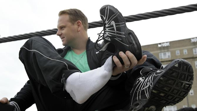 Nik Wallenda puts on his walking shoes before performing a walk on a tightrope during training for his walk over Niagara Falls in Niagara Falls, N.Y., Wednesday, May 16, 2012. Wallenda can't visit a new place without envisioning a wire strung high above his head: Linking buildings, landmarks, nations. Even as a 6-year-old at Niagara Falls with his parents, he pictured walking a tightrope over the raging, whitewater maw. Now 33, he's ready to live out that childhood fantasy when he attempts Friday, June 15, 2012 to become the first person ever to walk a tightrope directly over the brink of Niagara Falls. (AP Photo/David Duprey)