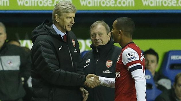 Arsenal's Theo Walcott is thanked by manager Arsene Wenger (Reuters)