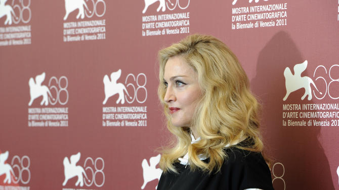 US singer and director Madonna poses at the photo call for the film W.E. during the 68th edition of the Venice Film Festival in Venice, Italy, Thursday, Sept. 1, 2011. (AP Photo/Jonathan Short)