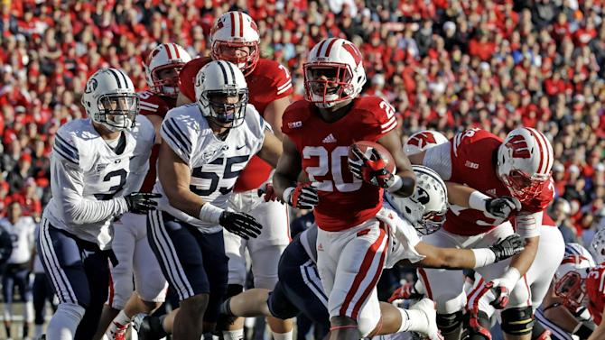 White has 3 TDs, No. 21 Badgers ground BYU 27-17