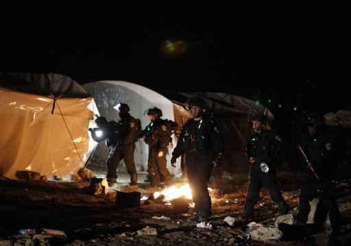 Israeli border police search an outpost of tents as they prepare to evacuate Palestinian protesters from the scene in an area known as E1, near Jerusalem