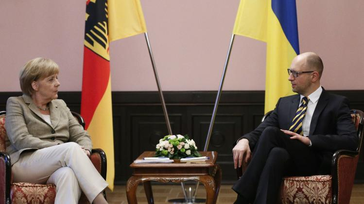 Ukraine's Prime Minister Arseny Yatseniuk meets with Germany's Chancellor Angela Merkel in Kiev