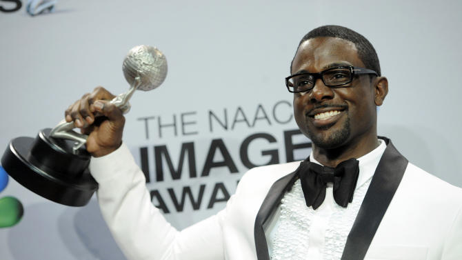 """Lance Gross poses backstage with the award for outstanding supporting actor in a comedy series for """"Tyler Perry's House of Payne"""" at the 44th Annual NAACP Image Awards at the Shrine Auditorium in Los Angeles on Friday, Feb. 1, 2013. (Photo by Chris Pizzello/Invision/AP)"""