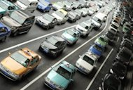 Vehicles queue up at an intersection in Shanghai. Vehicle sales in China rose 9.9 percent year on year in June, an industry group said showing a weakening recovery as the world's second largest economy continues to lose steam