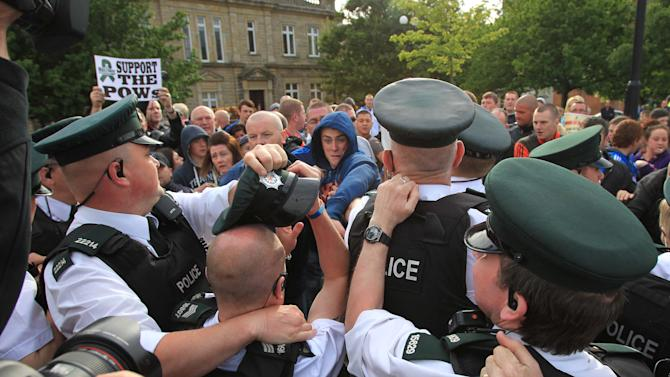 Protestors tussle with police as the Oly