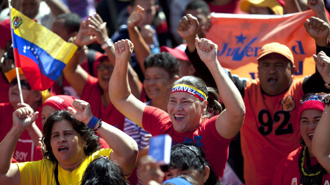 Supporters of Venezuela's President Hugo Chavez chant slogans as they gather for a rally in Caracas, Venezuela, Thursday, Jan. 10, 2013. The government organized the unusual show of support for the cancer-stricken leader on the streets outside Miraflores Palace on what was supposed to be his inauguration day.  Vice President Nicolas Maduro said that even though it wasn't an official swearing-in, Thursday's event still marks the start of a new term for the president following his re-election in October. (AP Photo/Ariana Cubillos)