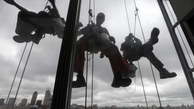 Cleaners work on the exterior of The Shard, a newly-constructed high-rise building that is western Europe's tallest, in London, Wednesday, July 4, 2012 ahead of its official inauguration on Thursday, July 5, 2012. The Shard is 309.6 meters tall (1,016 feet) and will feature high quality offices, a 5-star hotel with more than 200 rooms and suites and 3 floors of restaurants. It is financed by the Qatar government and will also feature exclusive super prime residential apartments and the top levels will consist of the capital's highest public viewing gallery offering 360° views of London. (AP Photo/Lefteris Pitarakis)