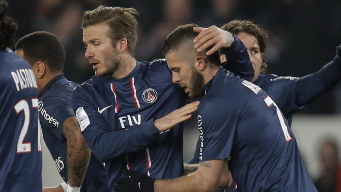 Paris Saint Germain's David Beckham, second left, celebrates with Jeremy Menez after their goal over Montpellier's during their League One soccer match between PSG and Montpellier at Parc des Princes Stadium, in Paris, Friday March 29, 2013. (AP Photo/Francois Mori)