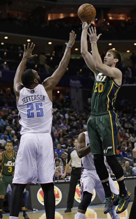 Utah Jazz's Gordon Hayward (20) shoots over Charlotte Bobcats' Al Jefferson (25) during the first half of an NBA basketball game in Charlotte, N.C., Saturday, Dec. 21, 2013. The Jazz won 88-85
