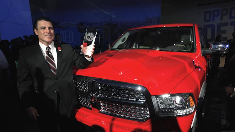 Fred Diaz, President and Chief Executive Officer, Ram Truck Brand, stands with the Ram 1500 after the vehicle was awarded the North American Truck of the Year at media previews for the North American International Auto Show in Detroit, Monday, Jan. 14, 2013.  (AP Photo/Paul Sancya)