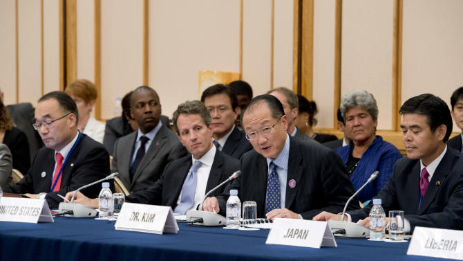 In this photo released by World Bank, World Bank President Jim Yong Kim, second right, speaks as South Korean Finance Minister Bahk Jae-wan, left, U.S. Treasury Secretary Timothy Geithner, second left, and Japan's Vice Finance Minister Tsutomu Okubo, right, listen to him at a ministerial meeting on the global agriculture and food security program at the annual meetings of the IMF and World Bank meetings in Tokyo Friday, Oct. 12, 2012. (AP Photo/Ryan Rayburn, World Bank) EDITORIAL USE ONLY