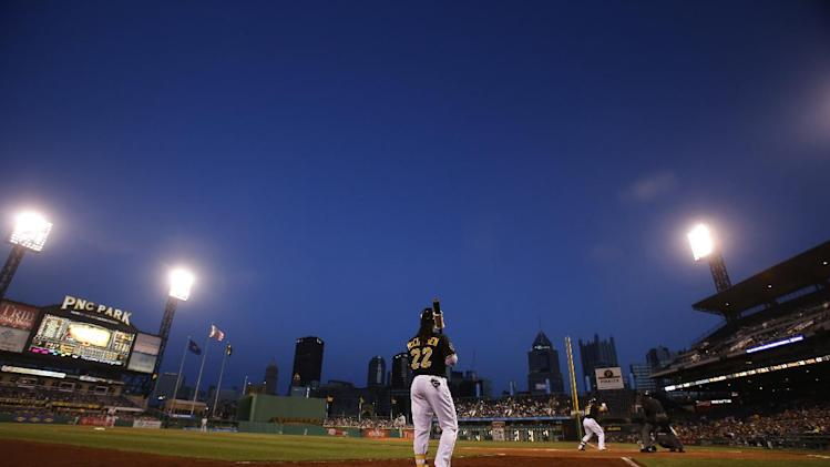 Pittsburgh Pirates' Andrew McCutchen (22) warms up on deck during the third inning of a baseball game against the Milwaukee Brewers in Pittsburgh Thursday, April 17, 2014. The Pirates won 11-2. (AP Photo/Gene J. Puskar)