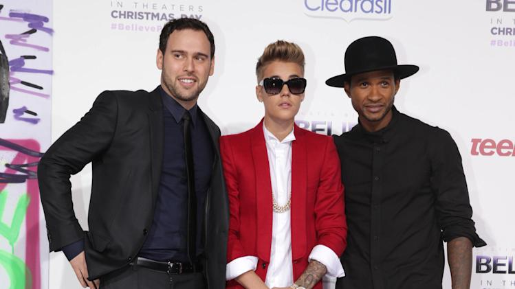 "Producer Scooter Braun, Justin Bieber and Usher Raymond seen at the World Premiere of Open Road's ""Justin Bieber's Believe"" presented by Teen Vogue and sponsored by Clearasil, on Wednesday, Dec. 18, 2013 in Los Angeles. (Photo by Eric Charbonneau/Invision for Open Road Films/AP Images)"