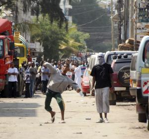 Muslim youth throw stones at riot police,  outside Masjid Musa Mosque, in Majengo, Mombasa, Kenya, Tuesday, Aug. 28, 2012. Police and protesters fought running battles as a violent backlash to the killing of a radical Islamic preacher continued Tuesday in Kenya's second largest city city of Mombasa, which left several people hospitalized, a police and human rights official said. Police officers teargased rowdy youth on their second day of protests over the killing Monday of Aboud Rogo Mohammed, who was sanctioned by the U.S. government and the U.N. for his alleged connection to an al-Qaida-linked Somali militant group, al-Shabab, regional Police boss Aggrey Adoli said. (AP Photo)