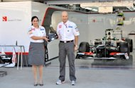 Peter Sauber (R), founder of Sauber F1 Team and Monisha Kaltenborn, newly appointed CEO of Sauber Motorsport AG, hold a Formula One car steering wheel during a photo session at the Korean Circuit in Yeongam, on October 11