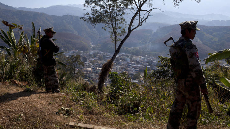 In this Jan. 31, 2013 photo, Kachin Independence Army soldiers guard a post on a hilltop overlooking the town of Laiza, where the guerrilla group's headquarters are located, in northern Myanmar's Kachin-controlled region. Kachin state is home to the last rebel insurgency left fighting in Myanmar that hasn't signed a cease-fire with President Thein Sein's government. Although the hills around Laiza have grown quiet for now, the dramatic upsurge in fighting underscored how far Myanmar is from achieving one of the things it needs most - a political settlement to end not just the war with the Kachin, but simmering conflicts with more than a dozen other rebel armies which have plagued the country for decades and still threaten its future. (AP Photo/Alexander F. Yuan)
