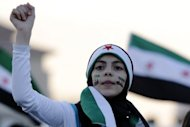 A Syrian resident in Jordan demonstrates outside the Syrian embassy in Amman on June 22. Syria confirmed on Saturday it had shot down a Turkish warplane over its territory, sparking a fresh crisis between the two countries, while accusing rebels of having massacred 25 of its supporters