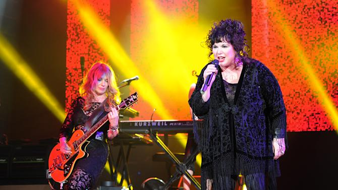 """FILE - This June 17, 2013 file photo shows Nancy Wilson, left, and Ann Wilson of Heart performing on opening night of the Heartbreaker Tour at the Cruzan Amphitheater in West Palm Beach, Fla. The group Heart is the latest act to cancel an appearance at SeaWorld Orlando's Bands, Brew & Barbecue music series in February. Country singer Willie Nelson and the rock group Barenaked Ladies also have canceled. A posting on Heart's official Twitter page over the weekend says the decision was influenced by the recently released documentary """"Blackfish."""" The documentary raises questions about the effects of captivity on killer whales at marine parks such as SeaWorld. (Photo by Jeff Daly/Invision/AP, File)"""