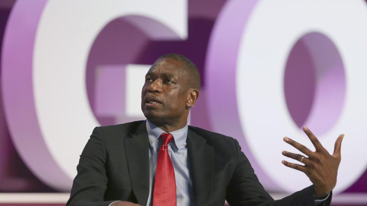 Mutombo, former NBA player for the Houston Rockets, speaks during the Doha GOALS forum in Doha