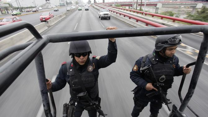Members of the Fuerza Civil (Civil Force) police patrol during a media presentation in Monterrey