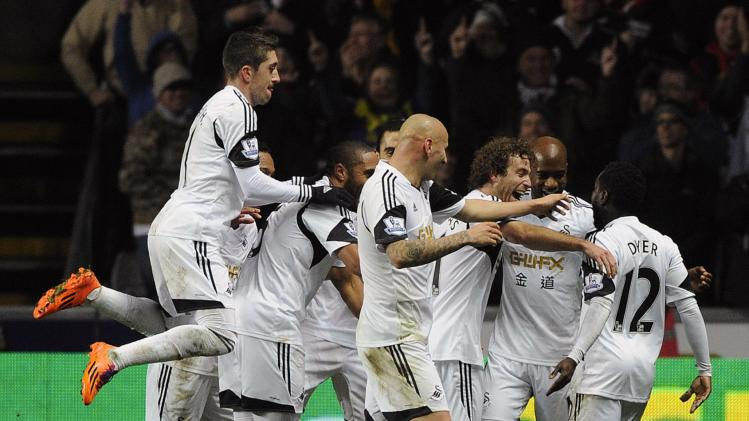 Swansea City's Dyer celebrates scoring a goal against Newcastle United with his teammates during their English Premier League match in Swansea
