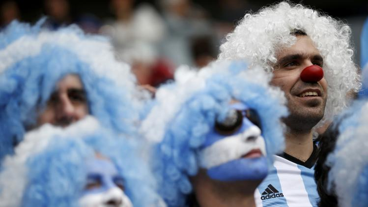 Argentinian fans attend the 2014 World Cup Group F soccer match against Nigeria at the Beira Rio stadium in Porto Alegre