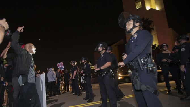Activists confront LAPD officers outside Police headquarters in Los Angeles, California