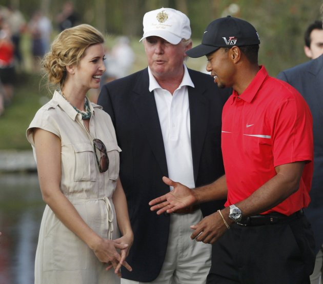 Woods is congratulated by Donald Trump and his daughter Ivanka after winning the 2013 WGC-Cadillac Championship PGA golf tournament in Doral