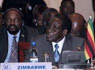 Zimbabwe's newly re-elected President Robert Mugabe speaks at a SADC summit in Lilongwe, on August 18, 2013. Veteran leader Mugabe will host a massive stadium-filling presidential inauguration to usher in a new five year term Thursday, despite expected limited attendance by foreign leaders and a boycott by his election rival