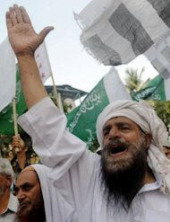 "Pakistani demonstrators shout slogans during a protest rally against the anti-Islam film in Karachi. Pakistan distanced itself Sunday from a cabinet minister's bounty for killing the maker of ""Innocence of Muslims"", as protests against the movie continued from Turkey to Hong Kong"