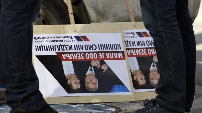 """A banner turned upside down, reading """"It's too small a country for such traitors"""" during the protest in front of the presidency building in Belgrade, Serbia, Tuesday, Feb. 5, 2013. Dozens of ultra-nationalists have accused Serbia's president of treason for agreeing to meet with his counterpart from Kosovo for the first time since the end of the war in 1999. The talks between Tomislav Nikolic and Atifete Jahjaga on Wednesday in Brussels, Belgium, will be part of an EU-brokered effort to improve ties between the former foes. (AP Photo/Darko Vojinovic)"""