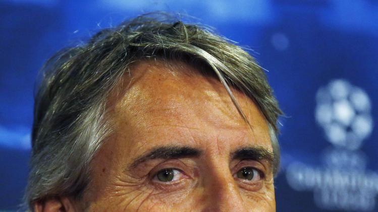 Galatasaray's Manager Roberto Mancini reacts during a news conference at Stamford Bridge in London