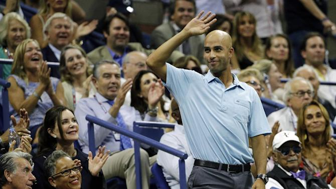 FILE - In this Sept. 11, 2015, file photo, former tennis pro James Blake, right, acknowledges applause during a semifinal match between Roger Federer, of Switzerland, and Stan Wawrinka, of Switzerland, at the U.S. Open tennis tournament, in New York. Two New York City police officers involved in the mistaken arrest of Blake, on Sept. 9, including one who allegedly tackled the former tennis star, will face an administrative trial after the city's police watchdog substantiated Blake's excessive force complaint, Mina Malik, the executive director of the New York City's Civilian Complaint Review Board said in a letter sent to Blake on Tuesday, Oct. 6. (AP Photo/David Goldman, File)