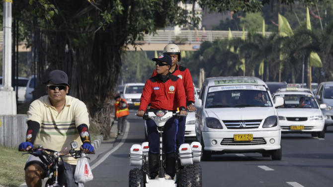 In this Friday Feb. 1, 2013 photo, MMDA (Metro Manila Development Authority) traffic enforcers patrol a street on their Segway vehicles as they help augment police security to hundreds of foreign delegates attending a five-day international convention in Manila, Philippines. Security problems are not new to the Philippines - kidnappings and bombings have plagued the south of the country for decades - but the latest rash of violence comes as President Benigno Aquino III tries to shore up foreign investments and restore Filipinos' confidence in their government. (AP Photo/Bullit Marquez)