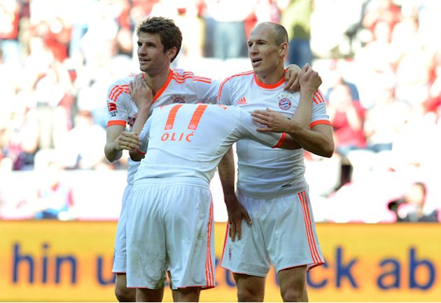 Bayern Munich's Striker Thomas Mueller, Bayern Munich's Croatian Striker Ivica Olic (C) And Bayern Munich's Dutch AFP/Getty Images