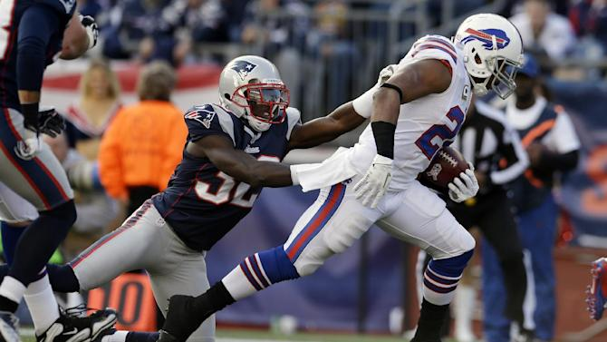 Buffalo Bills running back Fred Jackson (22) beats New England Patriots cornerback Devin McCourty (32) for a touchdown during the second quarter of an NFL football game at Gillette Stadium in Foxborough, Mass., Sunday, Nov. 11, 2012. (AP Photo/Elise Amendola)