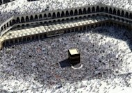 Muslim pilgrims walk around the Kaaba in the Grand Mosque in Mecca, 2011. More than 1,000 Nigerian women pilgrims remained stranded at a Saudi airport for a fifth straight day after being denied entry into the kingdom because they were not accompanied by men