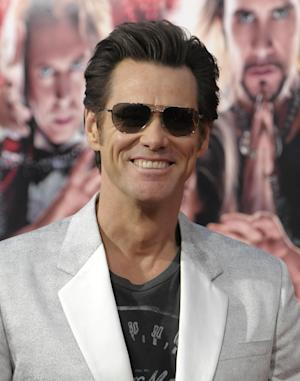 """Actor Jim Carrey arrives at the world premiere of the feature film """"The Incredible Burt Wonderstone"""" at the TCL Chinese Theatre on Monday, March 11, 2013 in Los Angeles. (Photo by Dan Steinberg/Invision/AP)"""